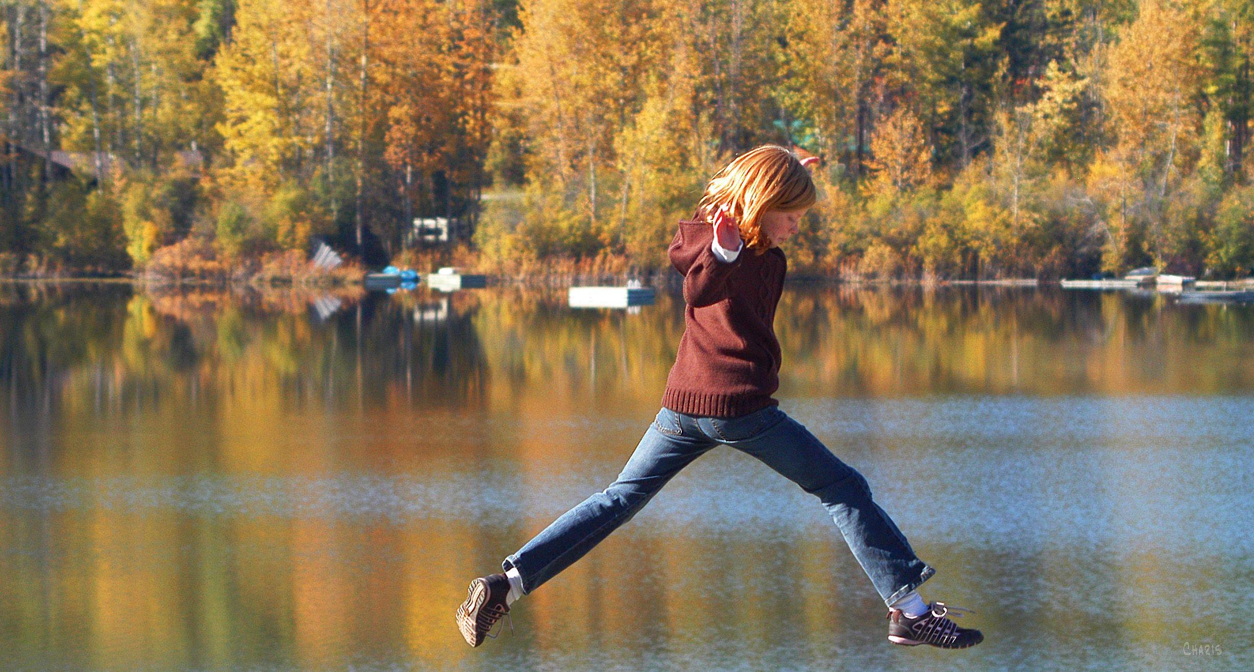 girl jumping autumn lake redhead DSC_0379