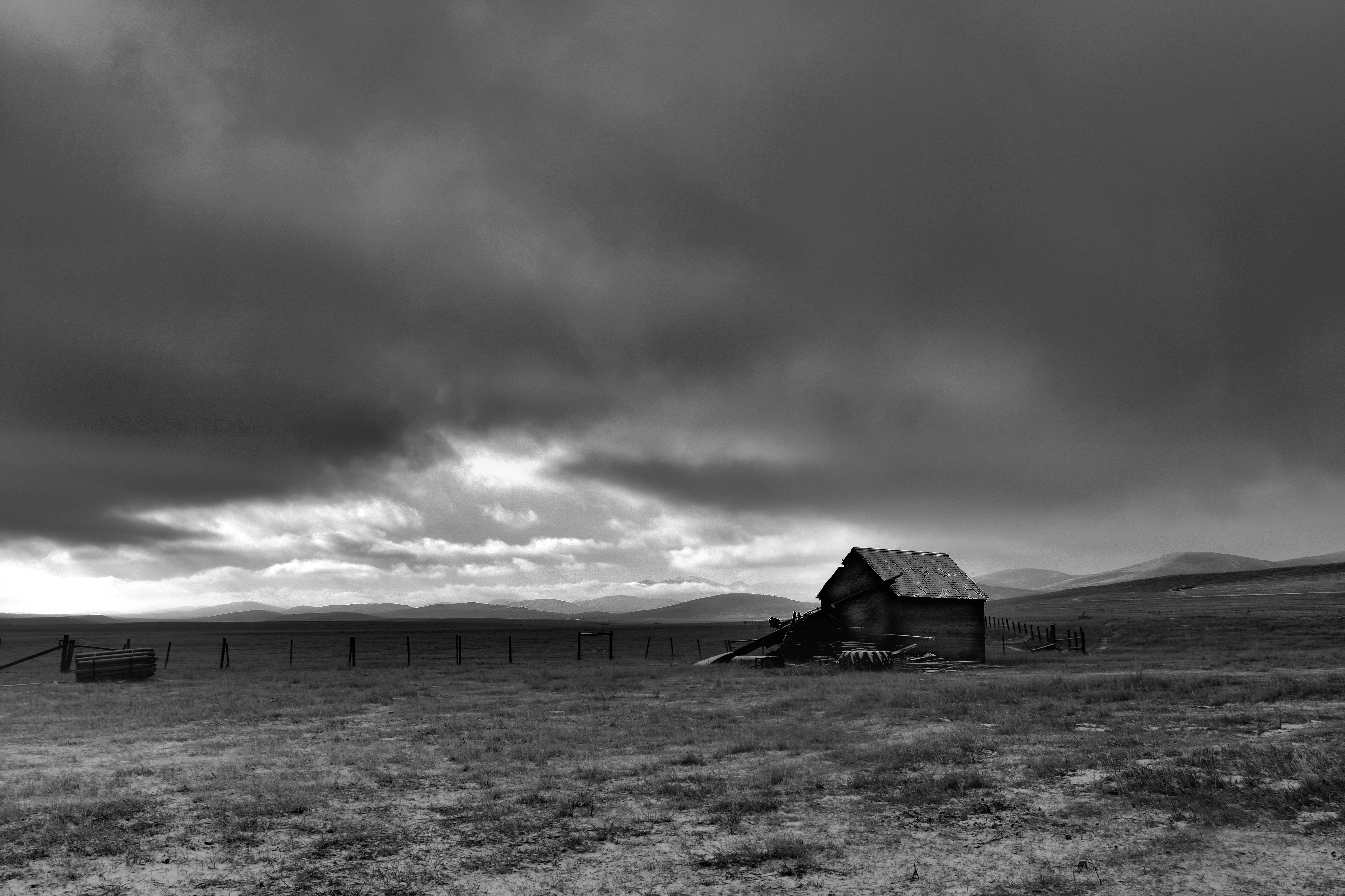 cowboy trail shack clouds bw DSC_0734